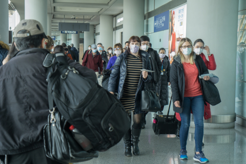 Beijing, China, January 31, 2010:  Beijing Capital International Airport during the outbreak of Corona virus. The virus has rapidly spread and became a global health emergency. At the airport everyone wear mask. Among the passengers are some foreigners / westerners.