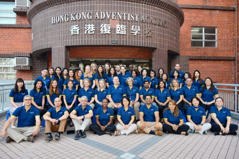 The Hong Kong Adventist Academy staff gathered for a yearbook photo. Credit: William Rios